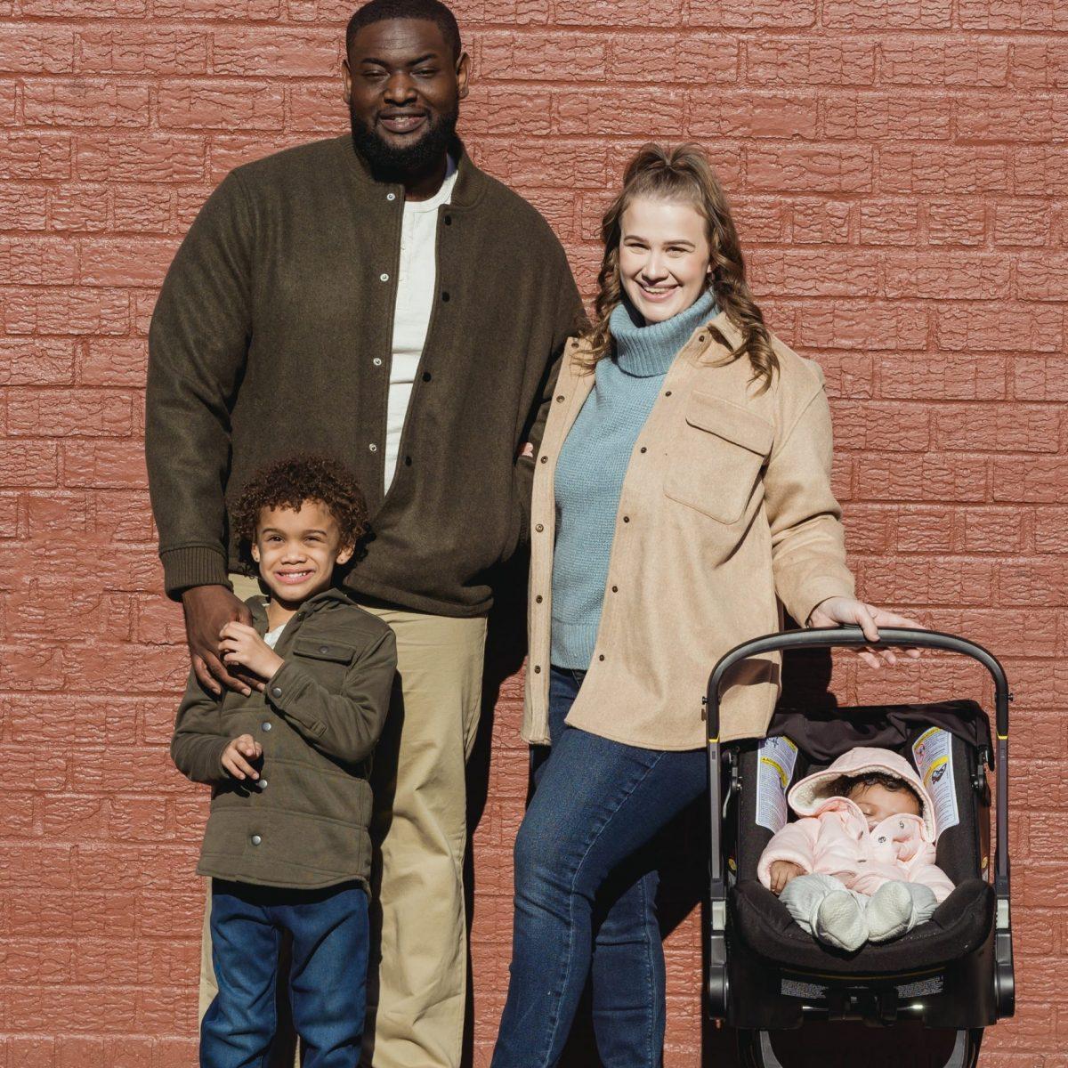 brown diversity family against wall vert